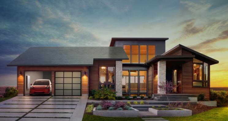 Po lewo Tesla Model 3, na górze dach solarny, gdzieś wewnątrz Powewall 2